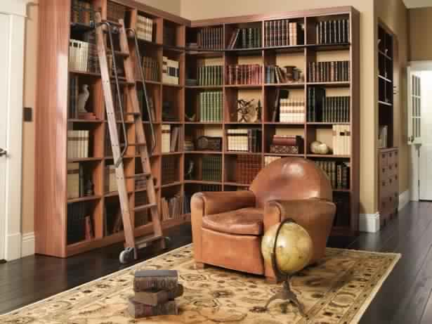 outstanding-home-library-with-wooden-shelf-and-brown-chair-with-patterned-rug-and-wooden-stair-615x461